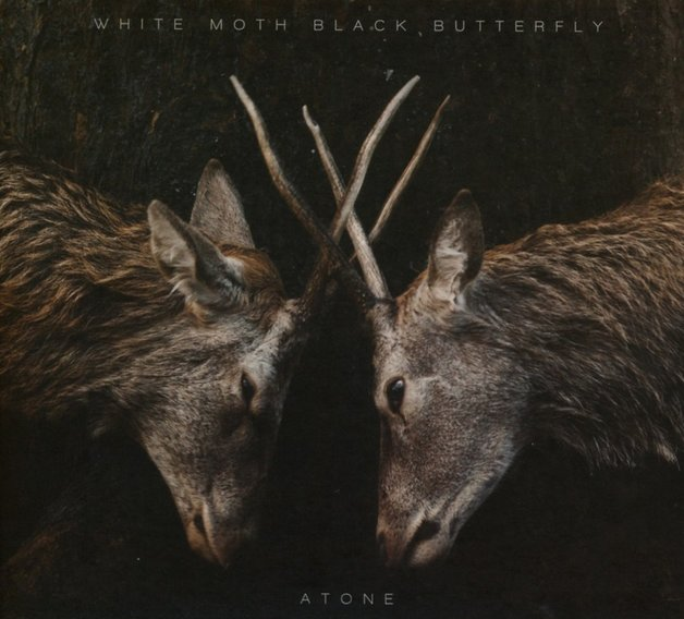 Atone by White Moth Black Butterfly
