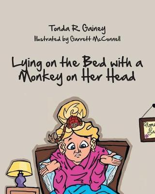 Lying on the Bed with a Monkey on Her Head by Tonda R Gainey image