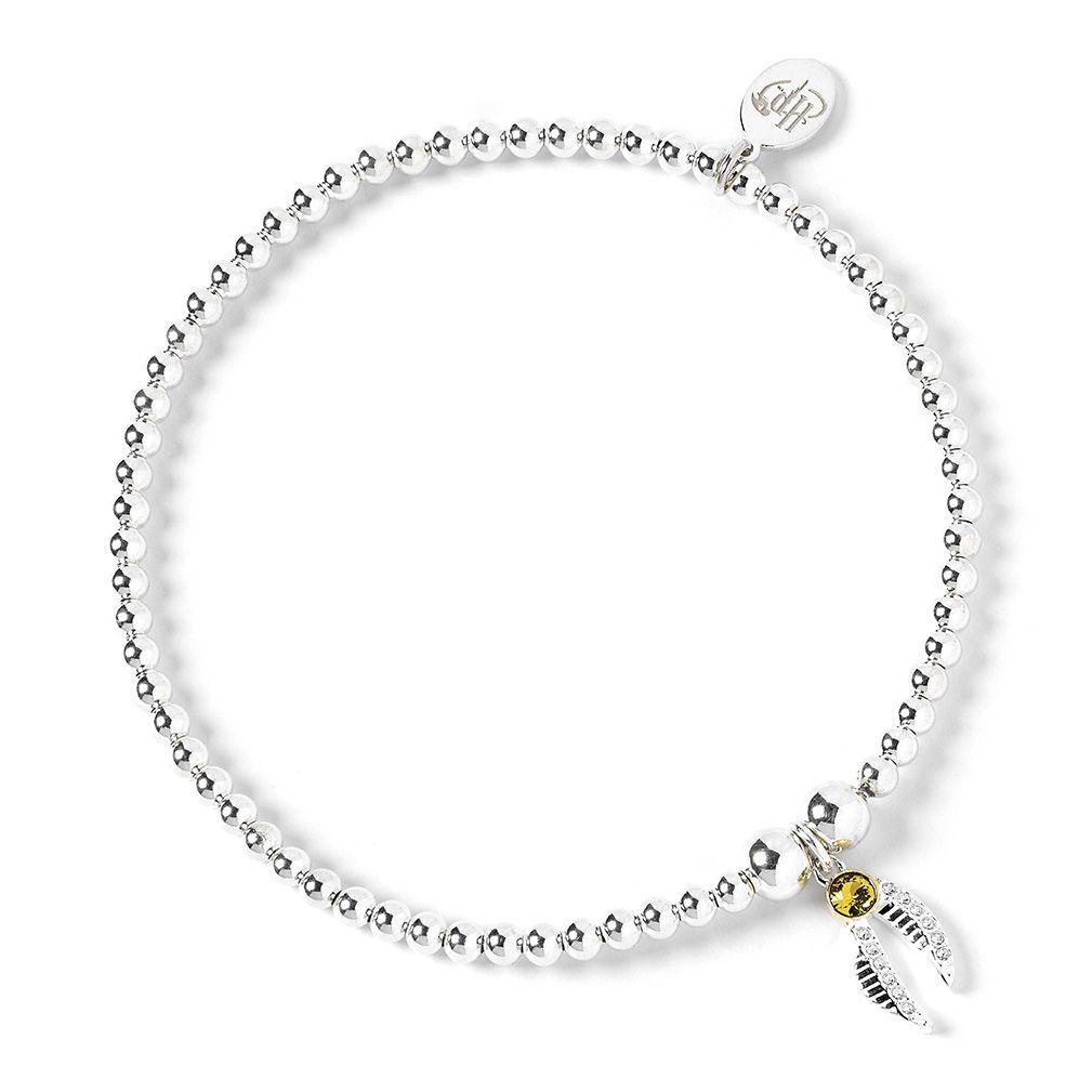 The Carat Shop: Harry Potter Sterling Silver Golden Snitch Charm on Ball Bead Bracelet Embellished with Swarovski Crystals image