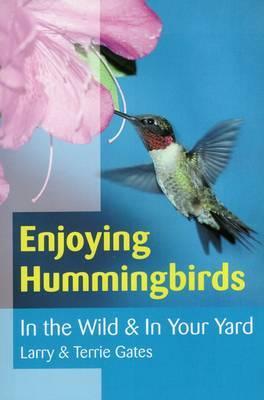 Enjoying Hummingbirds by Larry Gates