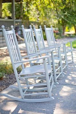 A Row of Four Rocking Chairs by Unique Journal