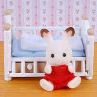 Sylvanian Families: Chocolate Rabbit Baby and Crib Bed Set.