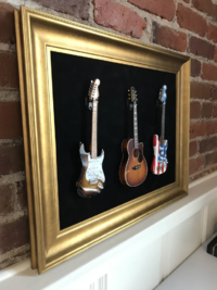 "Axe Heaven: Triple Mini Guitar Display Frame - Black Suede/Warm Gold Leafing (22"" x 18"")"