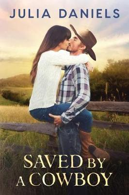 Saved by a Cowboy by Julia Daniels image