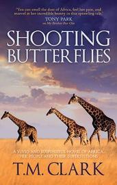 SHOOTING BUTTERFLIES by T M Clark