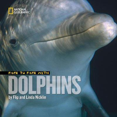 Face to Face with Dolphins by Flip Nicklin image
